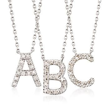 """Who doesn't want to see their name in lights? Illuminated with sparkling diamond accents, this initial necklace flashes a single capital letter in sterling silver (select options below). Stationed on a cable chain with a 2"""" extender and a lobster clasp. Diamond initial necklace. Free shipping & easy 30-day returns. Fabulous jewelry. Great prices. Since 1952."""