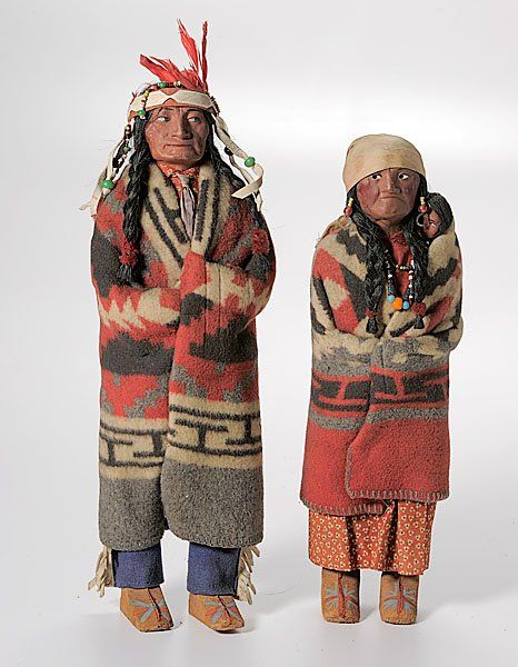 Skookum Indian Dolls  : Lot 475   These vintage dolls were dressed with scraps of early Trade blankets, some of them Pendleton. These look like they are authentic SW tribal weaving, though.
