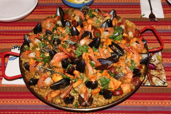 This is one of my all time favorite dishes. Ive been experimenting for a year now and I think Ive finally got it perfect. This recipe is for an 18 pallera cooked on an open flame (a weber grill works perfectly). For a smaller pan and stovetop cooking half the recipe. Note: Some purists say an authentic paella doesnt mix meat and seafood. I see it as a matter of taste, and most of the paella Ive had from various regions throughout Spain has been mixed. I leave the arguments to the old men in…