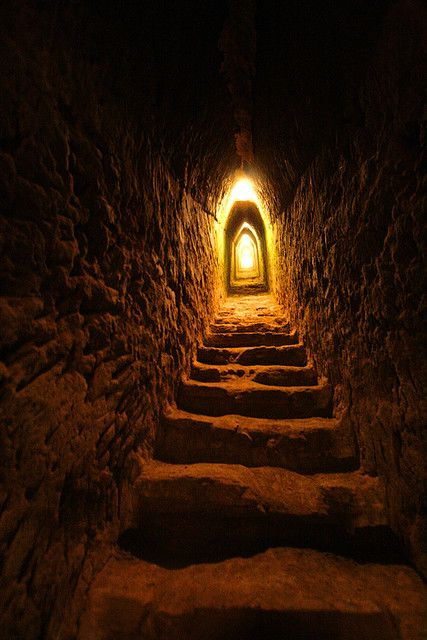 Inside the great pyramid of Cholula |  This passageway seems to go on a long way. The scene is claustrophobic and takes the eye towards the far end of the passageway looking for a way out.