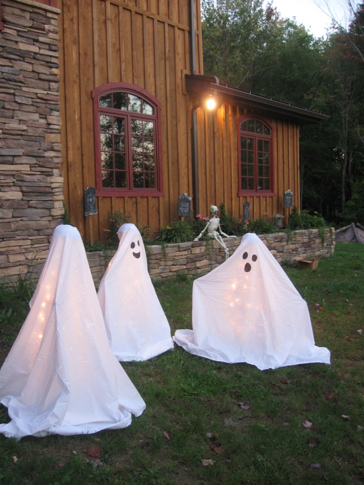 Easy DIY ghosts that I made...use tomatoe cage, place outdoor lights on it 50count or more, place something on the top of the cage (I glued styrofoam balls into cheap bowls), buy some cheap twin size white sheets, wrap it and there you have it friendly ghosties. I held sheets inplace with floral wire.: White Sheet