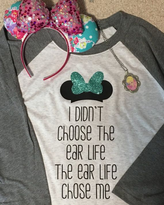 "Okay, I just had to share this shirt with you because it made me laugh out loud at my desk today. Sometimes all you need is a funny Disney inspired shirt to cheer you up on a rainy day. The shirt reads: ""I didn't choose the ear life, the ear life chose me."" I'm sorry, …"