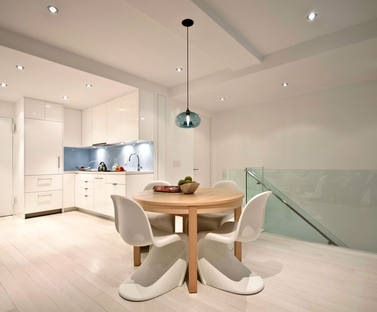 Niche Modern Aurora Pendant Light hanging over table Niche Modern