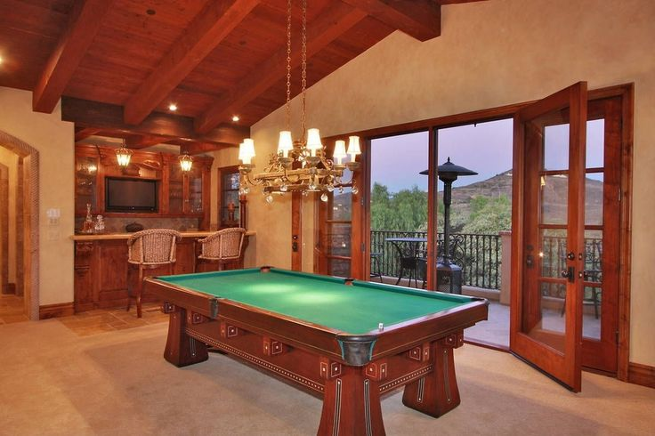 Mediterranean Game Room with Exposed beam, Sherwin Williams Faux Finish Crackle, High ceiling, Chandelier, limestone floors
