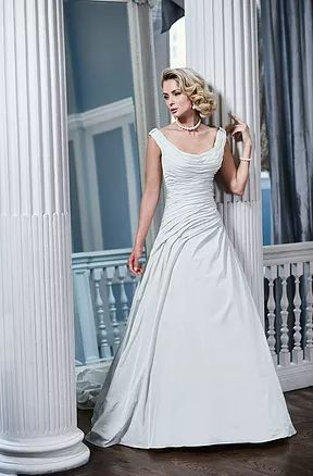 Devlin Bridal Couture   Designer Wedding Dresses   Trowbridge   Ian Stuart Laguna This elegant 1950's style inspired gown has an on or off shoulder and soft scoop neckline. The beautiful fine draping continues down the body and into the dropped waist and asymmetric small A line skirt. The back train includes a wrap over draped detail and leads into a chapel train.