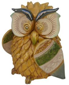Big Owl of La Terra Incantata Entirely handmade, modelled, caged, etched and coloured with ceramic Varnishes on Effects and ceramic Varnishes. It was created following the ancient Technics of the traditional Ceramic from Grottaglie and enriched with new ornamental Expressions.