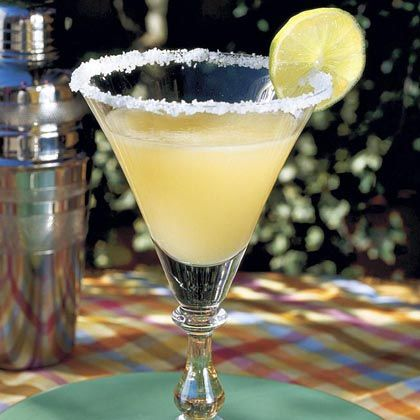 The only margarita recipe you'll need, this easy cocktail is a simple mix of shaken fresh lime juice, orange liqueur, tequila, and powdered sugar. For a shortcut, substitute frozen limeade concentrate for the lime juice and sugar. Like it slushy? Add ice and whiz the mixture in a blender. Make any size batch of this recipe and all the variations by simply multiplying the ingredient measurements by the desired number of servings. For larger batches, stir together all ingredients in a pitcher until powdered sugar is dissolved. Chill and serve over ice. For a sweeter drink, use 1/2 cup powdered sugar instead of 1/3 cup: Happy Hour, Lime Juice, Food, Cocktail, Margaritas, Margarita Recipes, Drink Recipes, Drinks