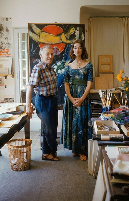 Model and artist Marc Chagall in his studio, 1955.   It is good to see this famous artist in his studio with some of his work in progress. Some how Chagall's model makes this space look so chic! http://en.wikipedia.org/wiki/Marc_Chagall