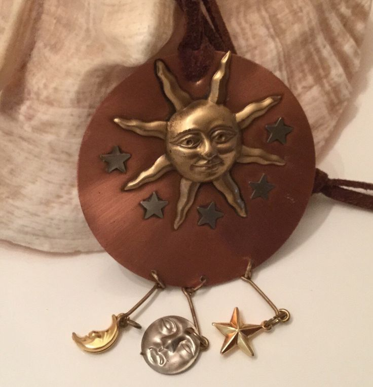 A personal favorite from my Etsy shop https://www.etsy.com/ca/listing/242525483/huge-sun-multi-charm-dangle-pendant-on
