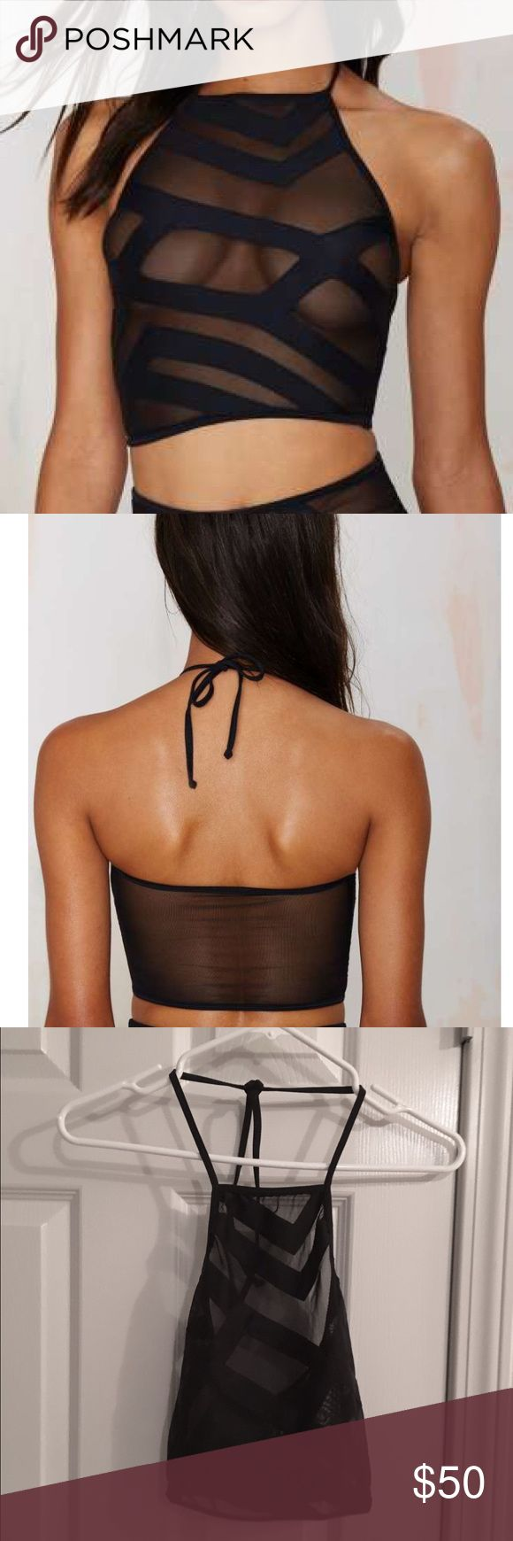 NWOT Lee + Lani Tel Aviv black semi sheer bikini NWOT Lee + Lani Tel Aviv black semi sheer bikini.  Like for love and lemons.  The tel Aviv top.  Geometric cut-out details and mesh. According to the site, small is best for A or B cup or size 2-4. Nasty Gal Swim Bikinis