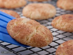 CAKE MIX SNICKERDOODLES  2 tablespoons sugar  1 teaspoon ground cinnamon  1 (18.25-ounce) package white cake mix  1/2 cup (1 stick) butter, melted  1 egg  1 teaspoon vanilla extract