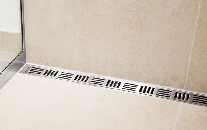 Bathroom - shower with linear floor drain. Elegant grating and frame in brushed stainless steel. Unidrain®: ClassicLine