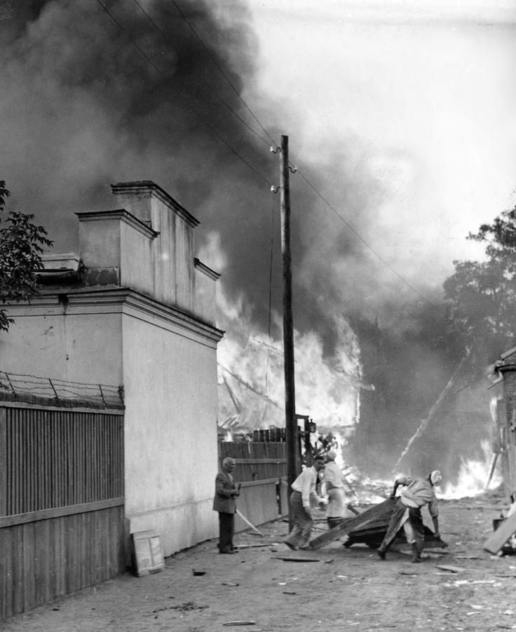 Polish civilians in the outskirts of Warsaw flee from burning buildings following a German Luftwaffe aerial strike during the German invasion of Poland. Warsaw, Masovian Voivodeship, Poland. September 1939. Pin by Paolo Marzioli