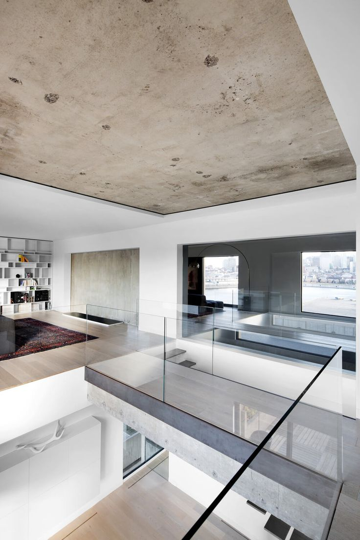Leave the slab exposed and frame it with low profile drywall ceiling and walls, include reveals. H67 by Studio Practice, Montreal Canada. #concrete #modern #interior