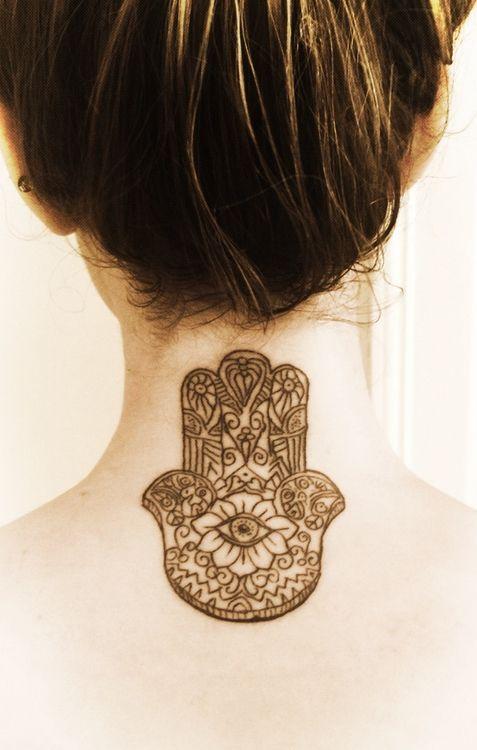 hamsa tattoo | hamsa hand on neck back black grey tattoo female neck
