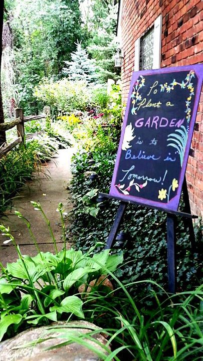 decorative chalkboard sign in the garden entrance!
