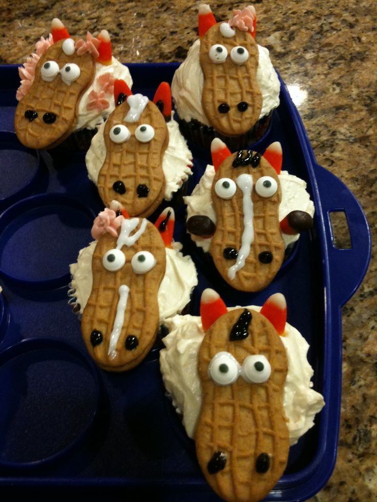 Horse cupcakes made with a Nutter Butter and some candy corn.