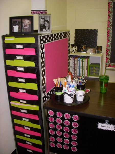 This teacher is a pro at maximizing space. Look at all of the folder and bulletin board space she created from the back and side of a file cabinet!  [Use magnetic board with direct attach on side of file cabinet,]