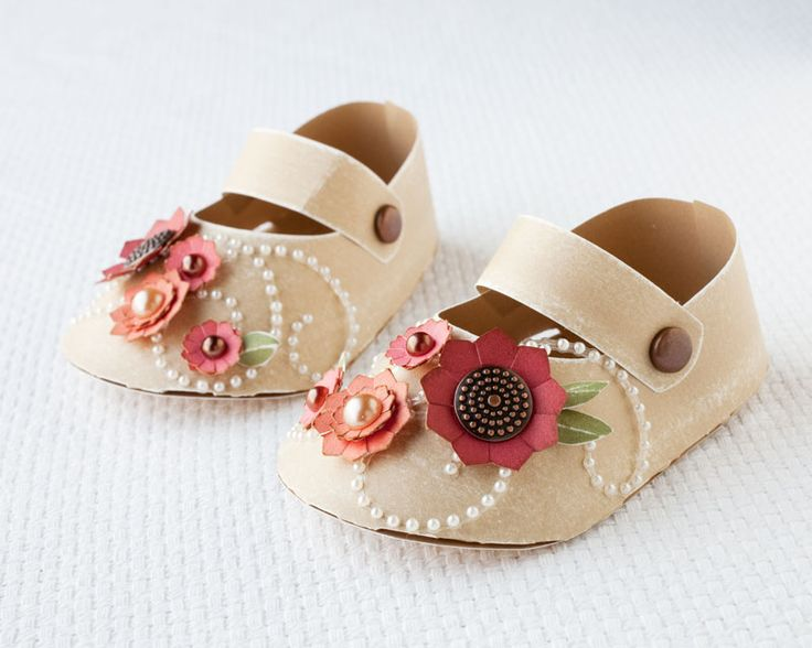 Paper baby shoes made with the Cricut® Artiste cartridge CTMH would be