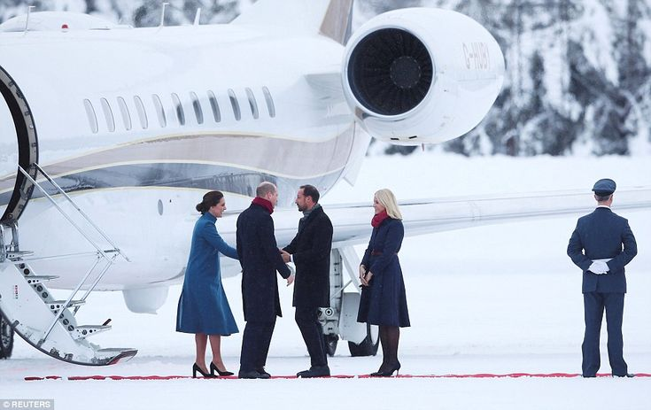 Snow queen! Kate braved the icy conditions in vertiginous heels, as did her host, former w...