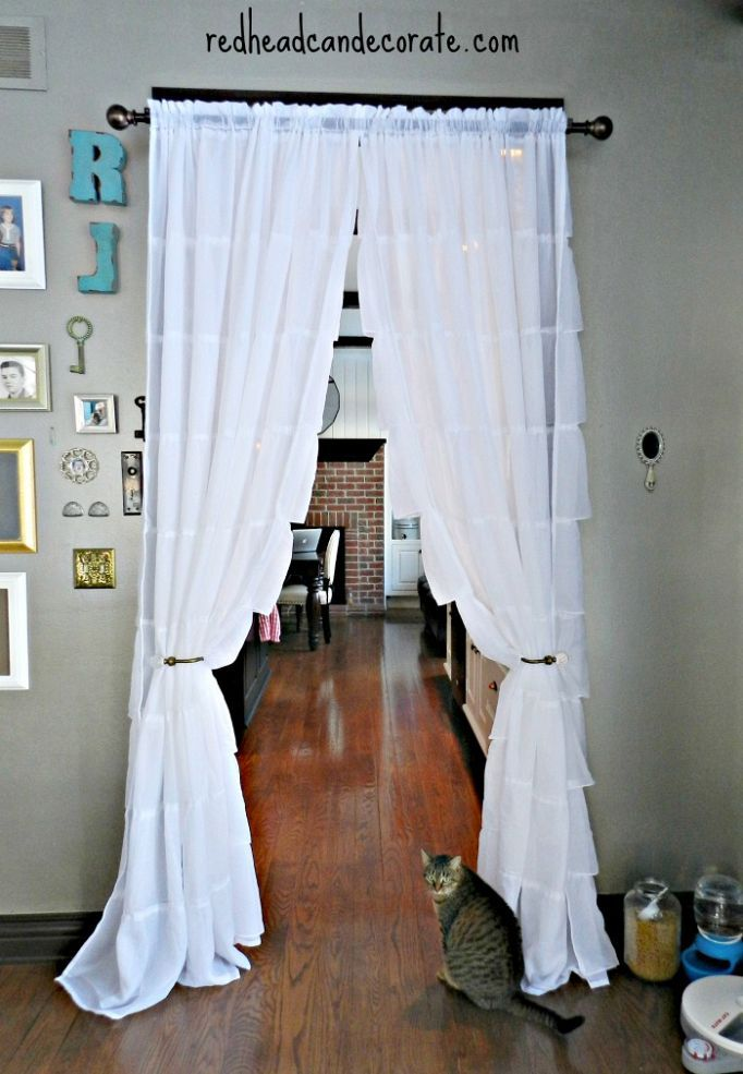 Hanging curtains in kitchen, and over doorways, to save on gas bill. Great idea!