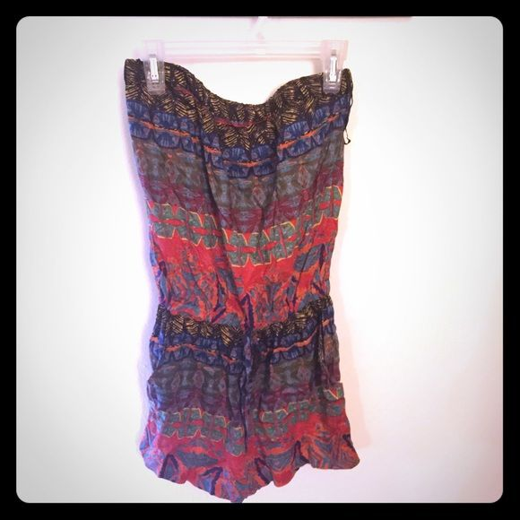 NWT Wet Seal Romper!! Very cute and comfortable wet seal romper. Has tie at the waist and pockets. Wet Seal Pants Jumpsuits & Rompers