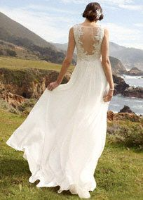 Breathtakingly beautiful, this exceptional illusion back sheath wedding dress is flawless.   Organic and soft in styling, this soft Chiffon is perfect for an outdoor affair.  Illusion back gives additional coverage while remaining soft and feminine.  Lightweight Chiffon fabric is the ultimate in providing an easy, effortless look.  Sweep Train.