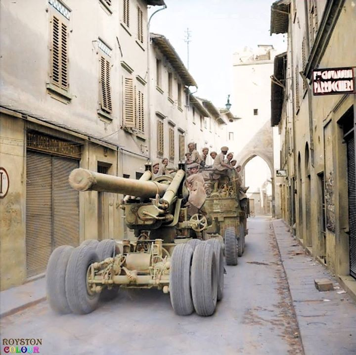 A 7.2-inch howitzer of the British Army's 75th Heavy Regiment, Royal Artillery being towed through the narrow Via Giuseppe Mazzini by the corner of Via Oreste Bandiniin in the commune of Borgo San Lorenzo, Florence in the Italian region of Tuscany. 12th of September 1944