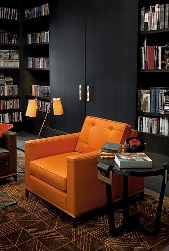 Library - Soft tangerine leather arm chair with reading light fixtures....perfect!