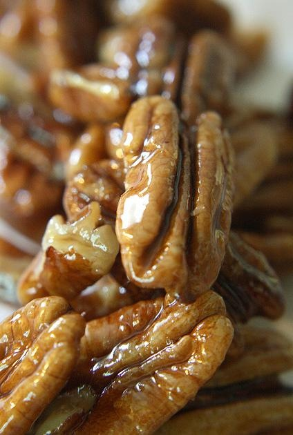 Candied pecans - great for salads You take 1/4 cup of pecans and put them in a small sauce pan with 2 tbsp of sugar and 2 tbsp of water. Stir to dissolve the sugar and bring to a boil. Immediately turn down the heat to a simmer for 5-7 minutes. You want them to be golden and coated. - bjl