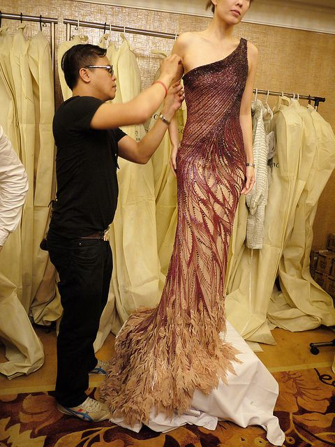 Michael Cinco. I would totally wear a non-traditional dress if it were this gorgeous.