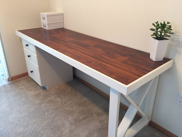 DIY Desk- old solid wood door topped with scrap laminate, scrap trim, restored base cabinet and 2x4 decorative leg. No staining needed! Pick your paint color and you have a perfect desk!