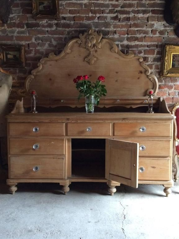 Antique sideboard, brick wall, roses