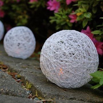 DIY Yarn Lanterns for Flameless Tea Lights and Votives- make these smaller for the tables