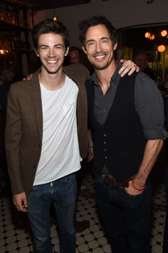 Grant Gustin and Tom Cavanagh attend the CW Network's 2015 Upfront party at Park Avenue Spring on May 14, 2015 in New York City.