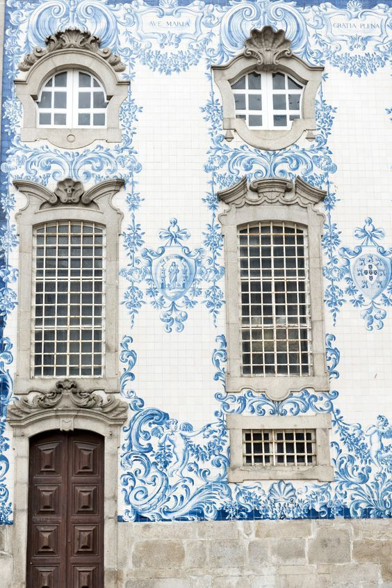 WOW beautfiful tiles on an old house fassade- i Love this architecture style