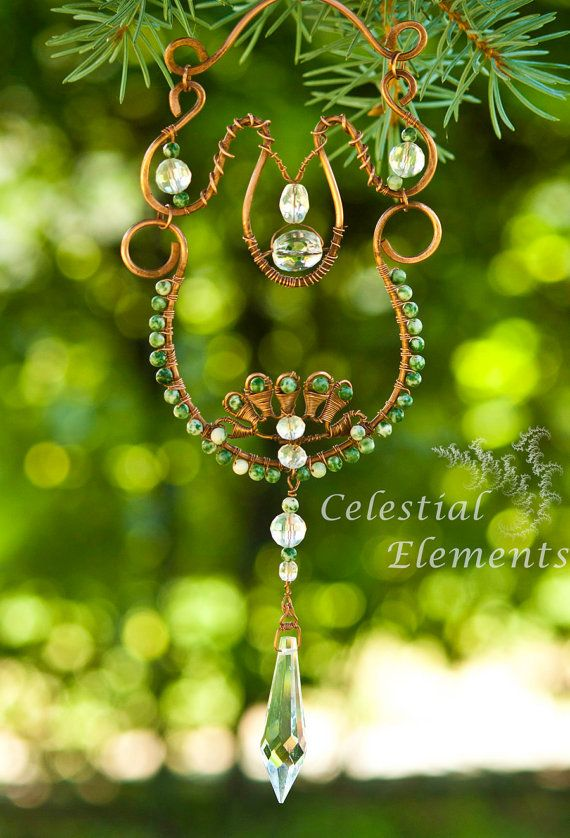 Homemade SunCatcher base has patina copper wire, gemstone beads wrap wire frame, lotuspetals at base, cystals embellish piece, drop crystal