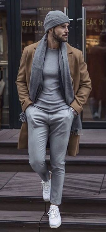 Fall combo inspiration with a gray beanie gray t-shirt gray scarf gray trousers brown camel hair topcoat silver watch white sneakers no show socks. #fallfashion #falloutfits #menswear #menstyle #mensapparel #scarf #topcoat #mensfashion #whiteshoes #whitesneakers #mensoutfits