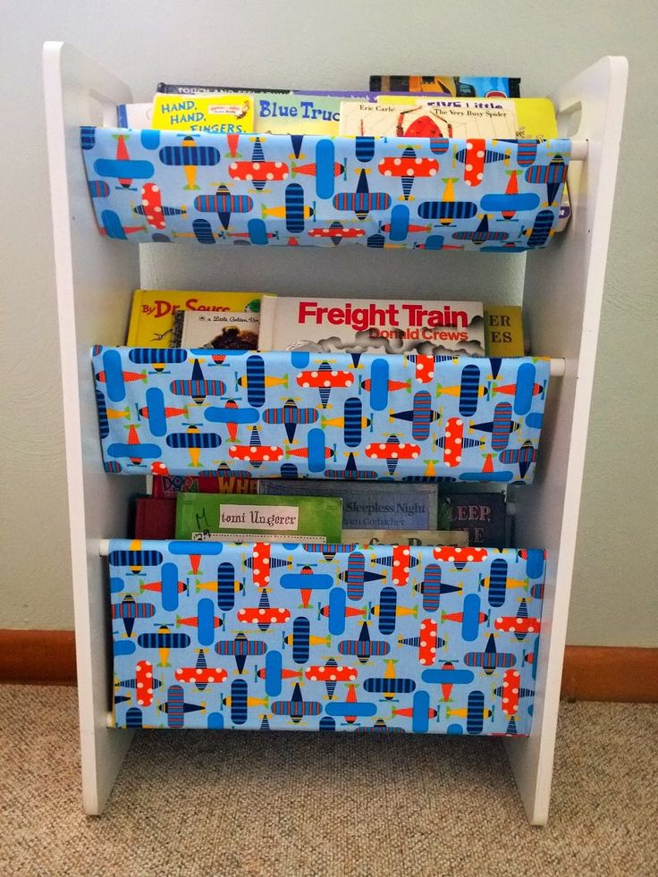 Repurpose an old toy storage bin rack into a sling book rack.