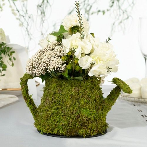 Whimsical moss table decorations suitable for a mad hatter party or better yet, a woodland themed baby shower!