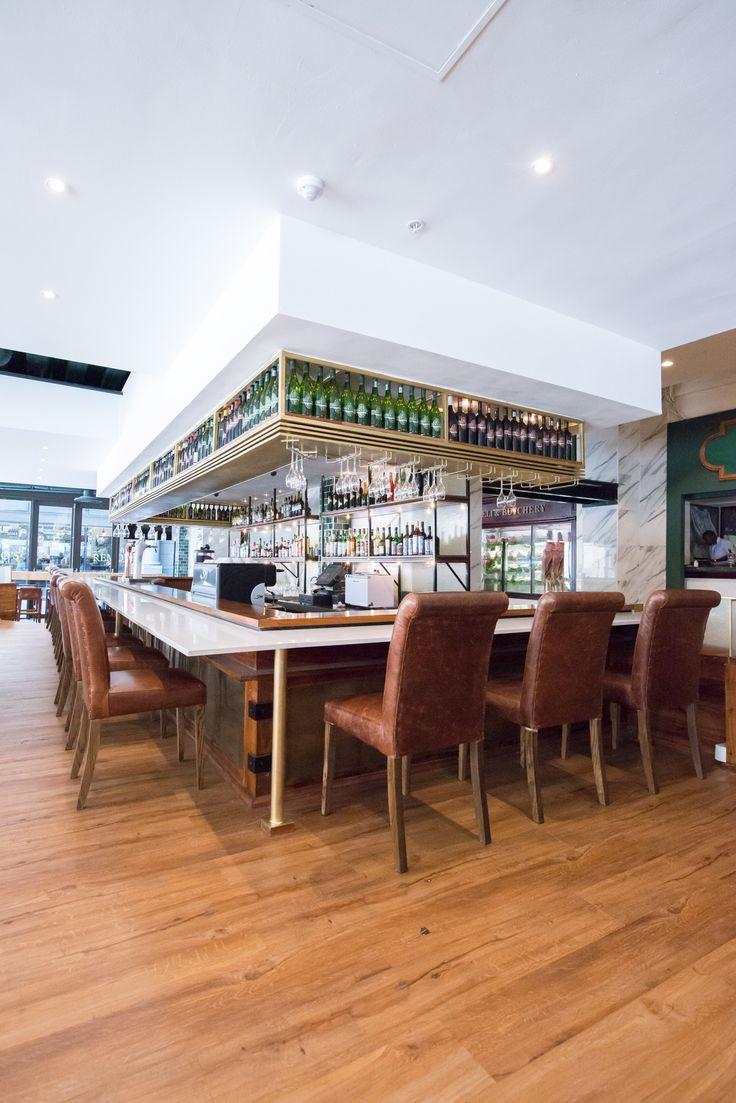 Inhouse Brand Architects gives The Butcher Shop & Grill in Sandton a modern makeover.  #interiordesign #interiors #restaurantinterior  #steakhouse #marble #butchershop