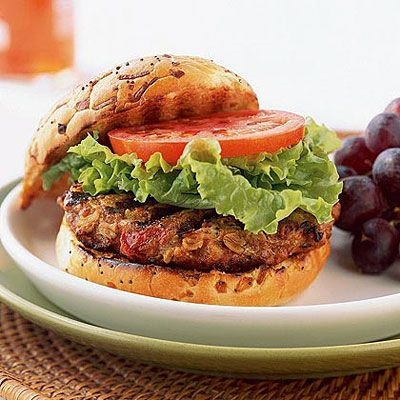 Turkey and Oat Burgers    Not only do oats give texture to these burgers, but they also provide figure-friendly fiber. Sweet onion, chili powder, and tomatoes add to the savory base, and onion sandwich buns finish this grilled treat off with a signature flavor.