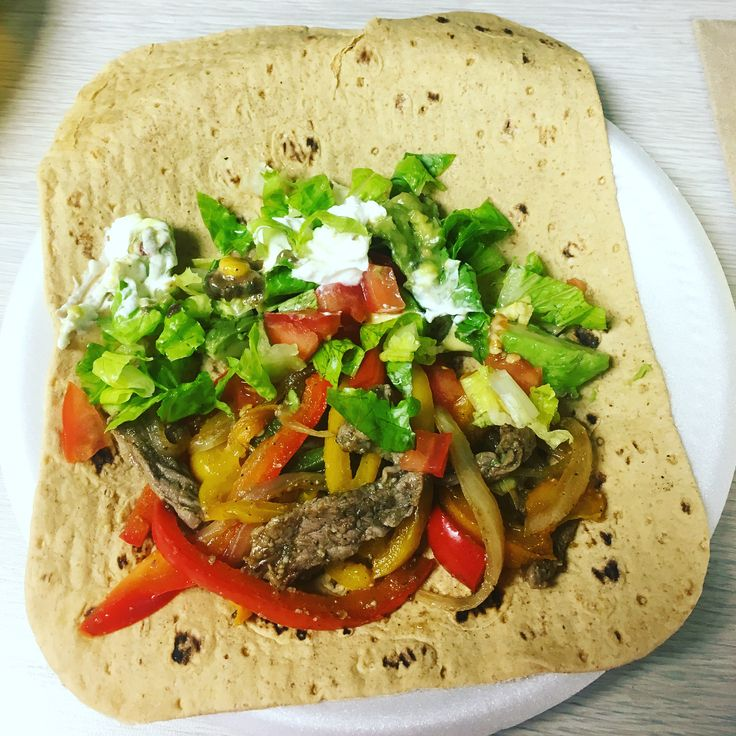 #macros #iifym #lunch #fajitas Calories 633 C62 P60 F24 #flexibleeating #homemade had two of these using fit&actice flatbread wraps, 4 colored peppers, onions, #steak cooked with salt, pepper, garlic, and cumin. Used Greek yogurt as sour cream, lettuce, tomato, avocado and wholly guacamole. So yummy!! #macroslife is the way #myfitnesspal keeps me in check #wrap always a #macrosgirl #iifymgirls #taco
