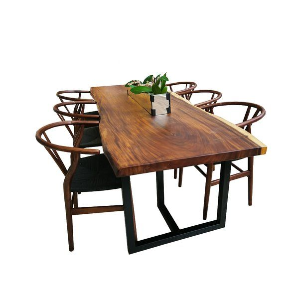 This Solid Wood Dining Table Has A Contemporary Metal Stand Made