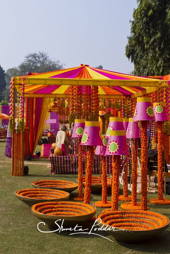 Funky Mehendi decor with buckets and marigold