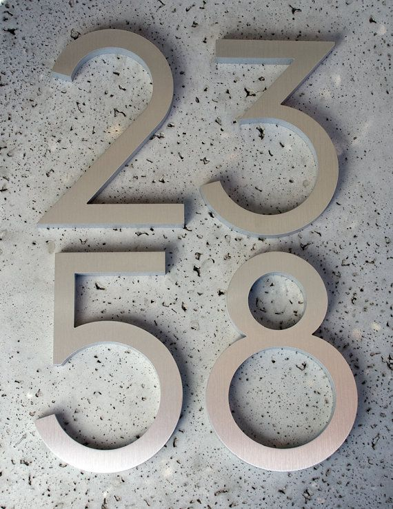 Beautiful house numbers made from recycled aluminum via Etsy...then anodize them dark bronze, perhaps.