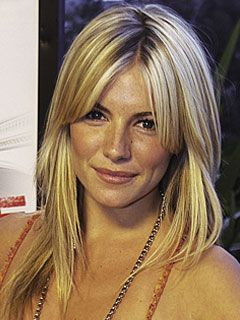 Sienna Miller Long Layered Hairstyle with side swept bangs