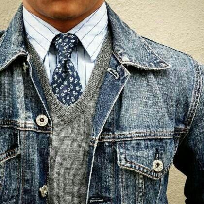 Denim jacket, grey v neck sweater, white pinstripe dress shirt, blue polka dots tie