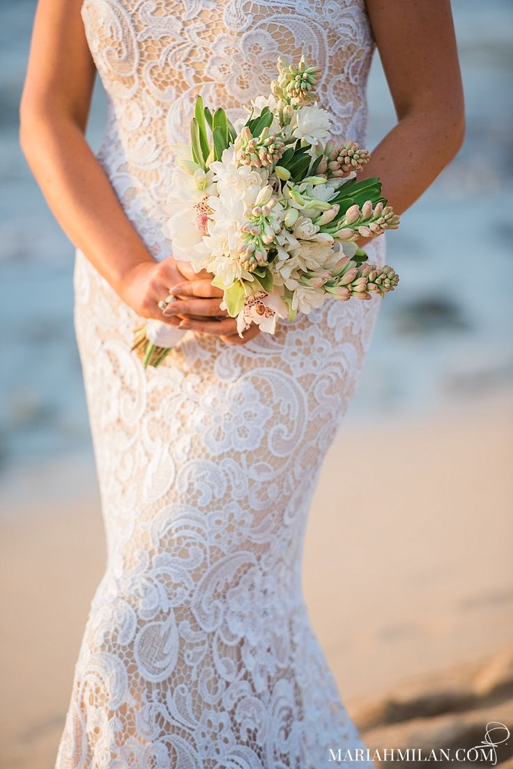 Lace illusion dress and tuberose wedding bouquet.   Flowers by: Petals Maui Photographer: Mariah Milan