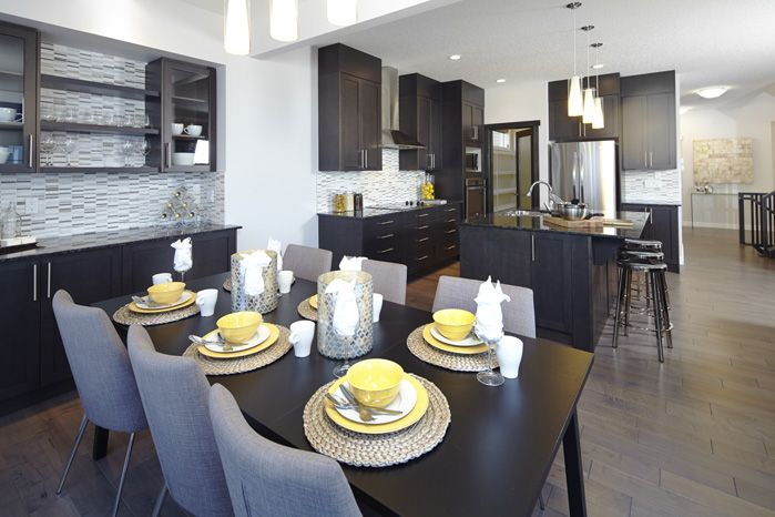 Open kitchen and nook layout in the Tofino II showhome in Hillcrest in Airdrie by Shane Homes.